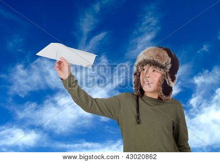 Airman Young playing with a paper airplane with the sky background