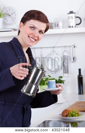 Woman In Her Kitchen Preparing Coffee With A Moka Pot