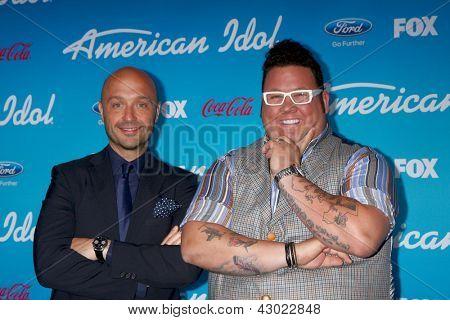LOS ANGELES - MAR 7: Vineyard owner and restaurateur Joe Bastianich (L) and chef Graham Elliott arrive at the 2013