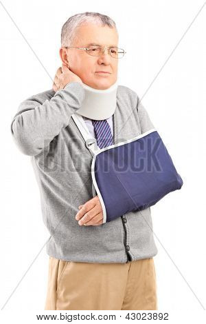 Senior man in pain with a broken arm holding his neck