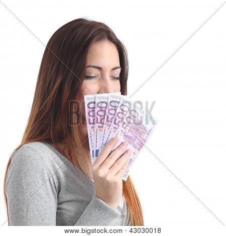 Beautiful Woman Smelling And Holding Five Hundred Euro Banknotes