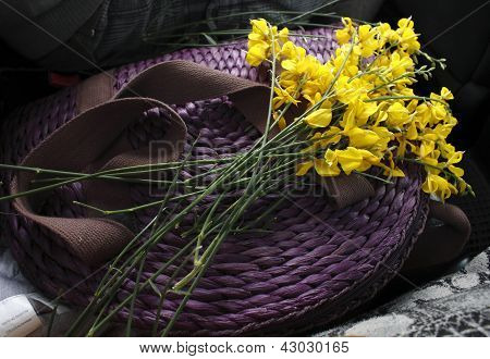Bouquet of yellow flowers on a purple purse