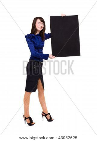 Smart young woman holding a blank board