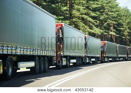 Lorry trucks cars in traffic jam at border zone custom