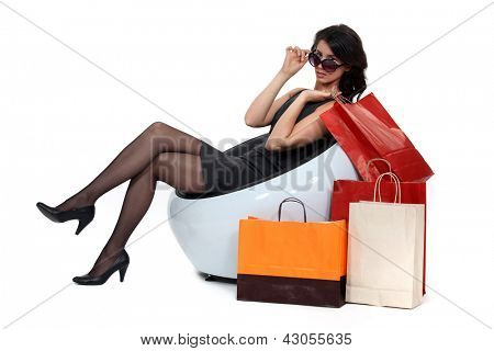 Glamorous woman surrounded by store bags