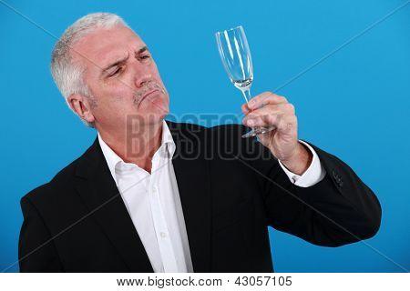 Man looking at glass