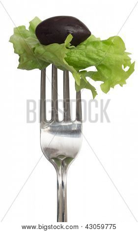 Green salad leaf and olive on the fork, diet concept