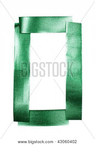 Color photograph of alphabet of green tape