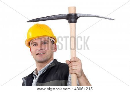 Man proudly displaying pick-axe