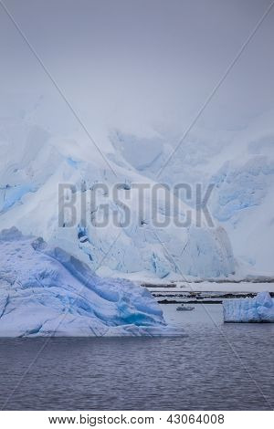 Antarctic Iceberg In The Morning Mist