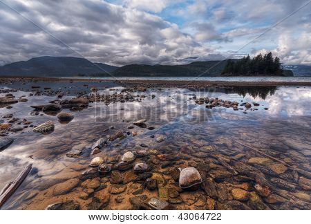 Colorful Rocks And Sweeping Landscape Reflection