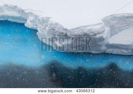 Snow Falling On Iceberg Ledge