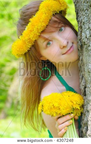 Beautiful Girl With Red Hair And Diadem From Yellow Dandelions On Head