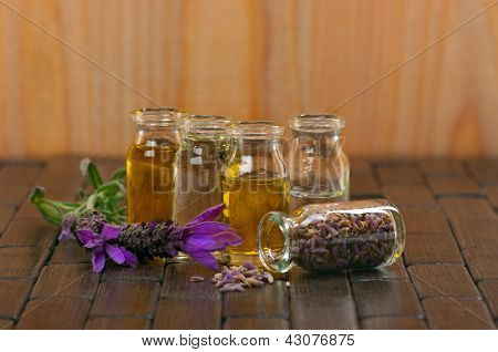 Spa concept with aromatic lavender and massage oils