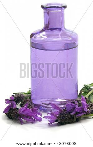 Spa concept with aromatic lavender and massage oil