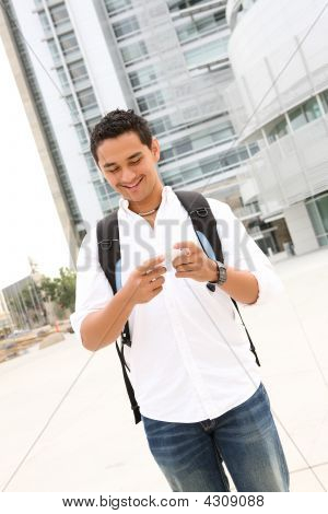 Male Student Texting At School