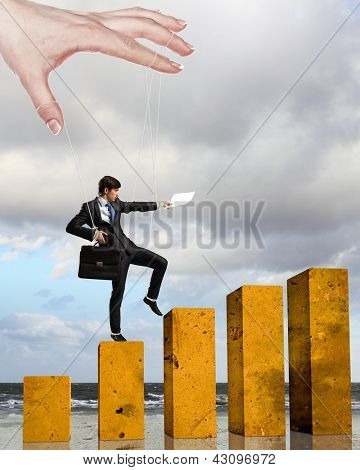 Businessman marionette on ropes controlled by puppeteer walking on bars
