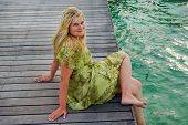 pic of kuramathi  - Young woman on wooden landing stage on Maldivian island - JPG