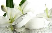 stock photo of lilly  - Cosmetic cream and beautiful lily - JPG