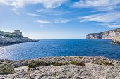 stock photo of gozo  - Xlendi Bay in Malta situated in the south west of the island of Gozo - JPG