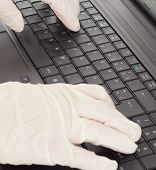 stock photo of lobbyist  - A person typing on the computer keyboard - JPG