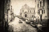 stock photo of gondolier  - Vintage image of Venice canals Italy Europe - JPG