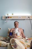 foto of pacemaker  - Patient with pacemaker after heart surgery in a hospital ward - JPG