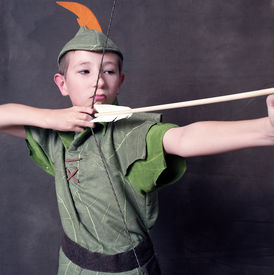 picture of fletching  - Young Robin Hood drawing a bow and arrow - JPG