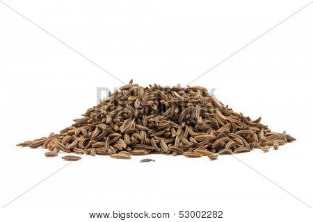 Pile of cumin seeds isolated on white background