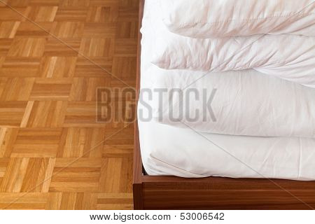 Tucked Blanket And Bed Sheet In Double Bed