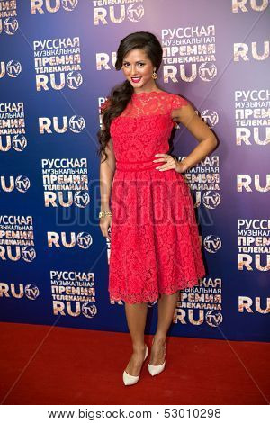 MOSCOW - MAY 25: Singer Nusha in red dress on Russian Music Award channel RUTV in Crocus City Hall on May 25, 2013 in Moscow, Russia.
