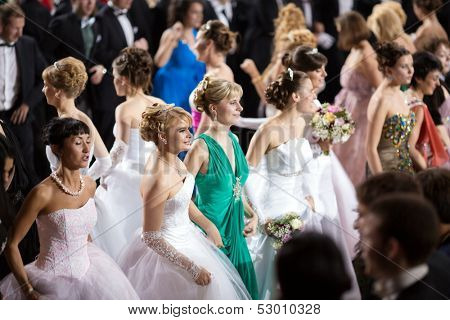 MOSCOW - MAY 25: Girls in elegant dress at 11th Viennese Ball in Gostiny Dvor on May 25, 2013 in Moscow, Russia.