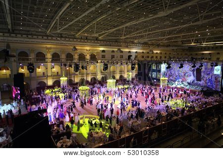 MOSCOW - MAY 25: Hall with tables and beautiful people at 11th Viennese Ball in Gostiny Dvor on May 25, 2013 in Moscow, Russia.