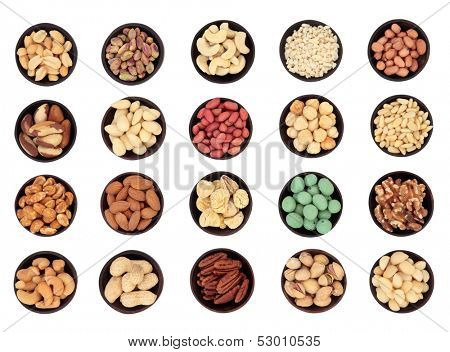 Large nut selection in wooden bowls over white background. Not a composite.