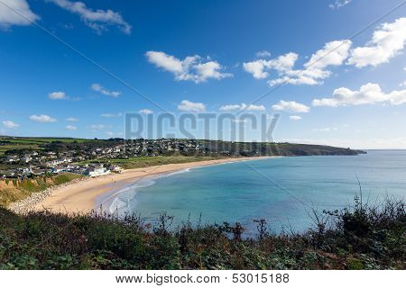 Praa Sands Cornwall England UK with blue sky and clouds