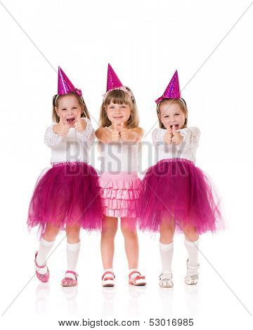 Cute little girls showing thumbs up, isolated on white background