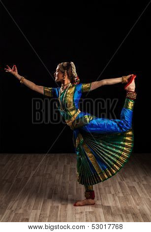 Young beautiful woman dancer exponent of Indian classical dance Bharatanatyam