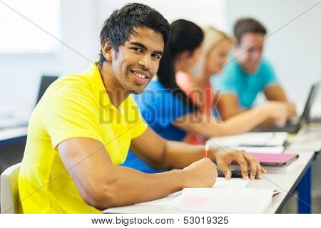 good looking indian college student in lecture room