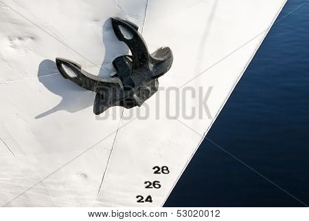 Close Up Photo Of A Black Ship's Mooring Anchor On White Painted Bow With Draft Scale Numbering