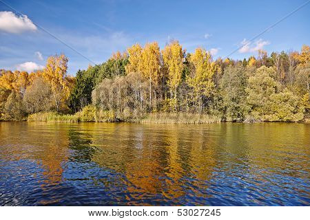 Sunny Autumn Day On The Lake In Russia