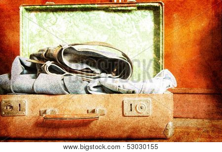 Vintage Suitcase a on wooden background