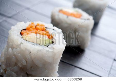 Shallow Focus Horizontal Macro Of 3 Rolls Of Sushi