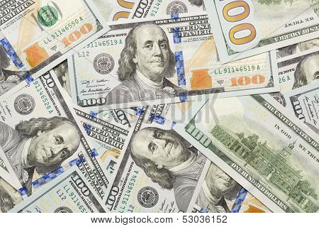 Several Scattered Layer of the Newly Designed U.S. One Hundred Dollar Bills.