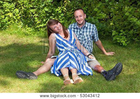 Happy Attractive Couple Relaxing In The Garden