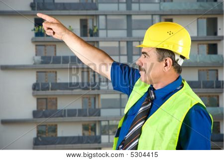 Mature Architect Pointing On Site