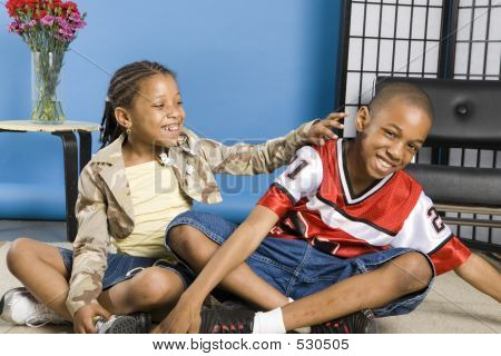 Tickling Her Brother