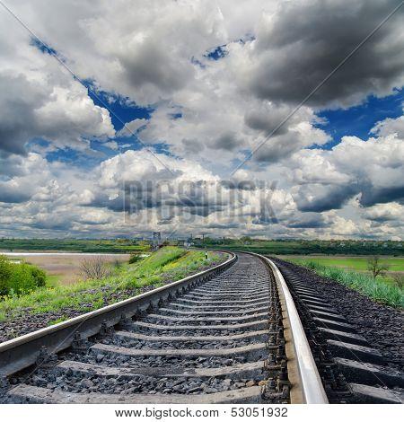 dramatic sky and railroad to horizon
