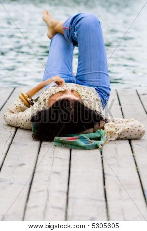 Woman Lying Near The River