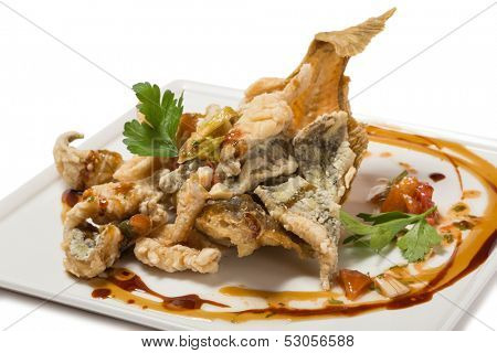 Fried flounder in the Eastern, tomato concasse with sweet and sour sauce.