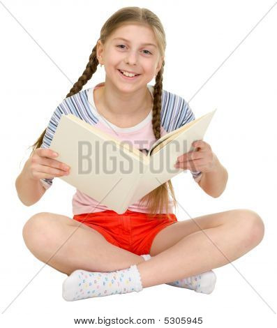 Small Happy Girl With The Book In Hands